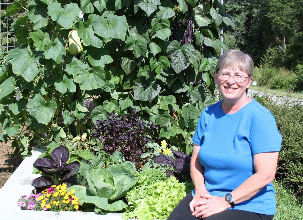 Photo of Debra in her square foot garden