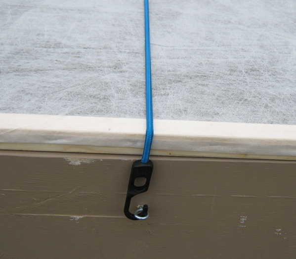 Securing cover with bungee cord